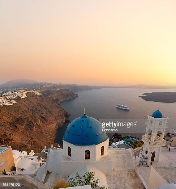 Santorini bell tower and blue domes in Oia on Greece