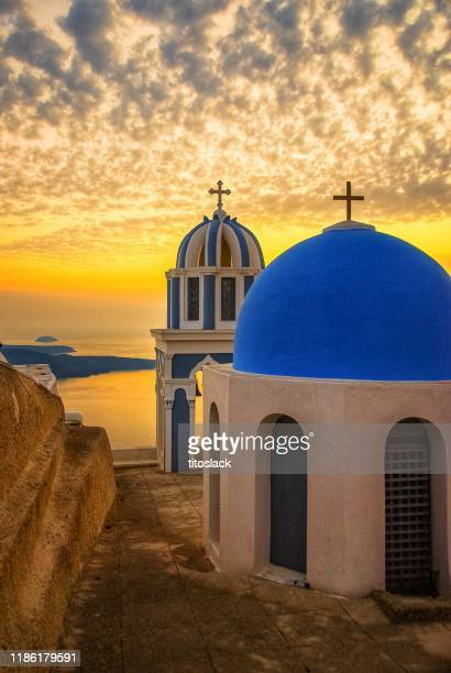 santorini chapels at sunset - greek orthodoxy stock pictures, royalty-free photos & images
