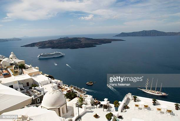 Santorini island with ships in the background