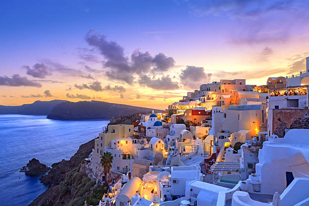 santorini sunset at dawn village of oia greece - santorini, greece stock photos and pictures