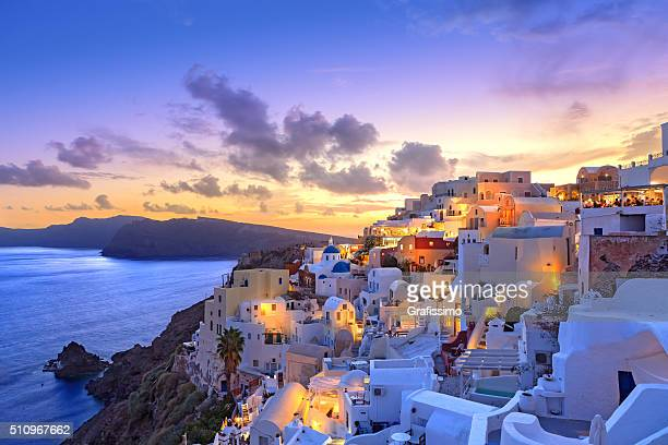 santorini sunset at dawn village of oia greece - idyllic stock pictures, royalty-free photos & images