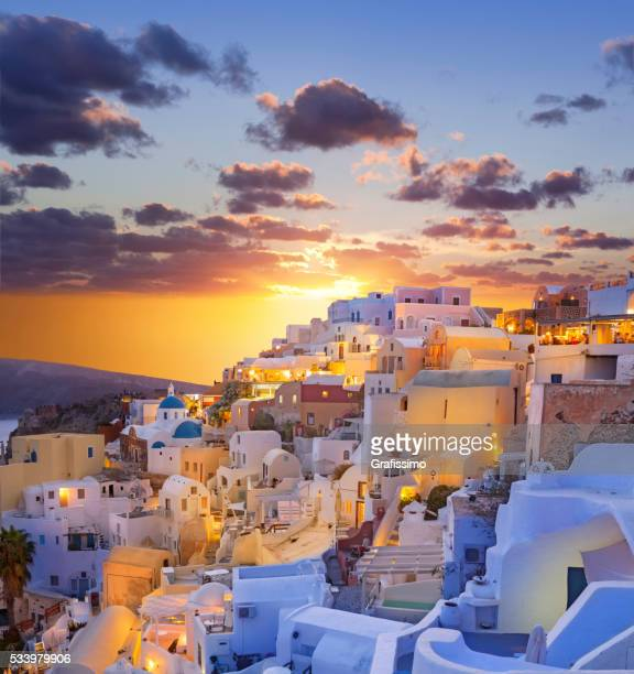 santorini sunset over the village of oia in greece - greece stock pictures, royalty-free photos & images