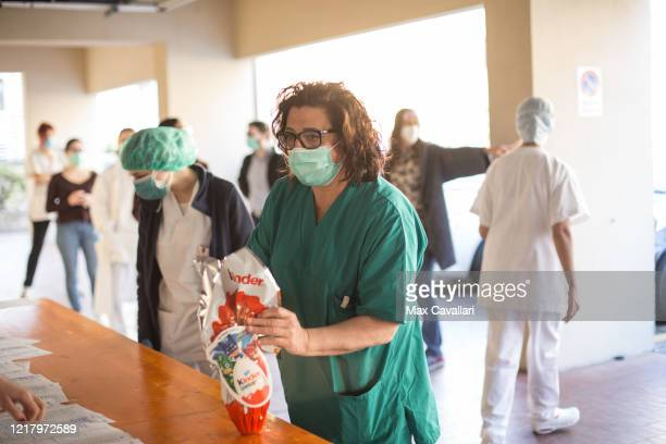 Sant'Orsola Hospital's team in partnership with Ferrero distribute chocolate eggs for Easter to all employees including doctors nurses and medical...