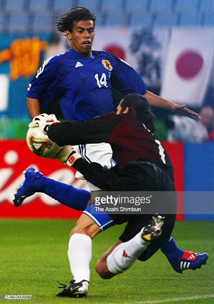 Santos Alessandro of Japan and Rustu Recber of Turkey compete for the ball during the FIFA World Cup Korea/Japan round of 16 match between Japan and...