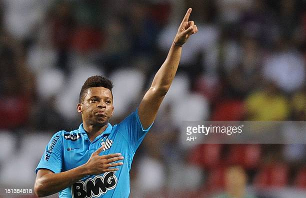 Santos' Andre celebrates after scoring against Fluminense during a Brazilian Championship football match at the Joao Havelange stadium in Rio de...