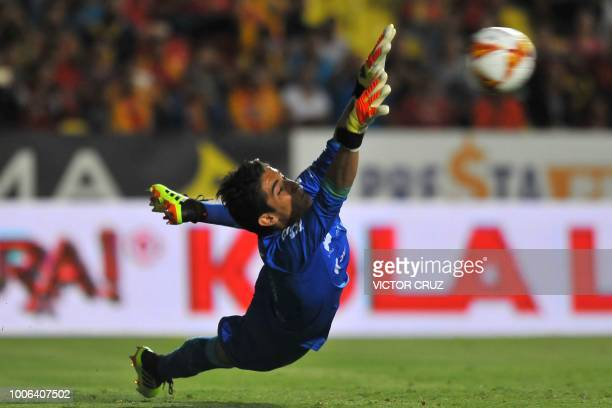 Santos goalkeeper Carlos Acevedo tries to stop the ball during a penalty shot during a Mexican Apertura 2018 tournament football match against...
