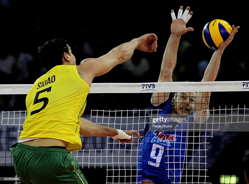 Santos Junior Sidnei Dos of Brazil spikes the ball as Ivan Zaytev of Italy blocks during the FIVB World League Final Six semifinal match between Italy and Brazil at Mandela Forum on July 19, 2014 in Florence, Italy.