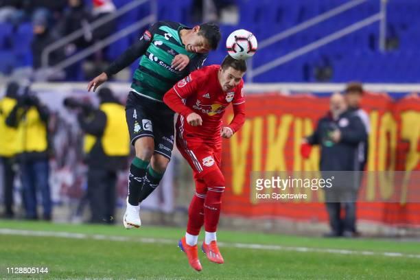 Santos Laguna defender Jesus Angulo battles New York Red Bulls midfielder Alex Muyl during the first half of the CONCACAF Champions League...
