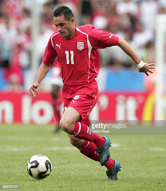 Santos of Tunisia runs with the ball during the FIFA Confederations Cup Match between Argentina and Tunisia on June 15 2005 in Cologne Germany