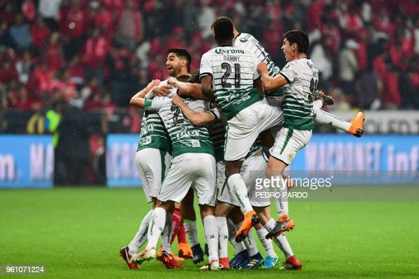 Santos' players celebrate after winning the Mexican Clausura 2018 tournament final football match against Toluca at the Nemesio Diez stadium in...