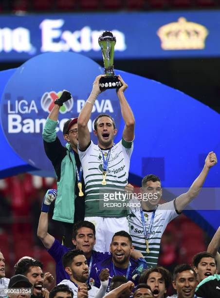 Santos players hold their trophy following their victory over Toluca in the Mexican Clausura 2018 tournament final at the Nemesio Diez stadium in...