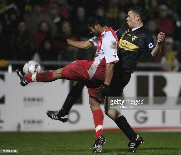 Santos Sidney of Cottbus tackles Erik Meijer of Aachen during the Second Bundesliga match between Alemannia Aachen and Energie Cottbus at the Tivoli...