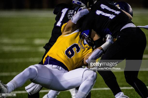 Santos Villarreal III of the University of Mary HardinBaylor tackles Braeden Friss of the University of Mount Union during the Division III Men's...