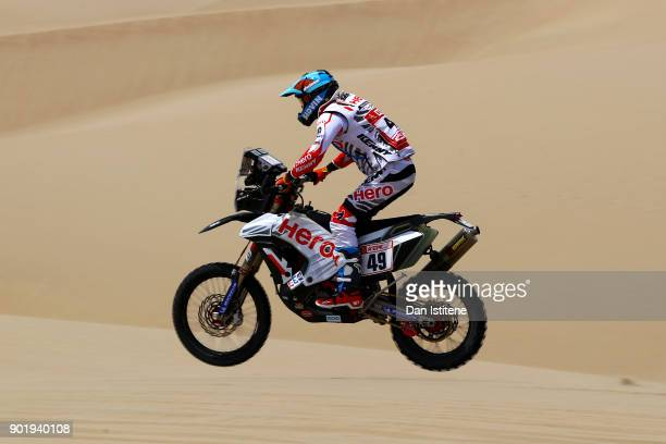 Santosh Chunchunguppe Shivashankar of India and Hero Motorsports rides a 450 Rally Hero bike in the Classe 21 Super Production during stage one of...