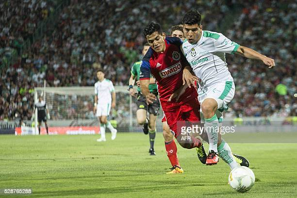 Santos's defender Nestor Araujo vies for the ball with Guadalajara's defender Jesus Sanchez during their Mexican Clausura tournament football match...