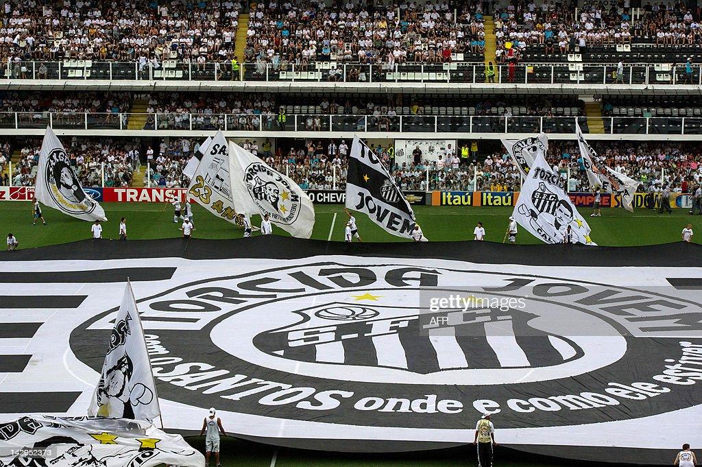 Santos's supporters flutter flags celebr : News Photo