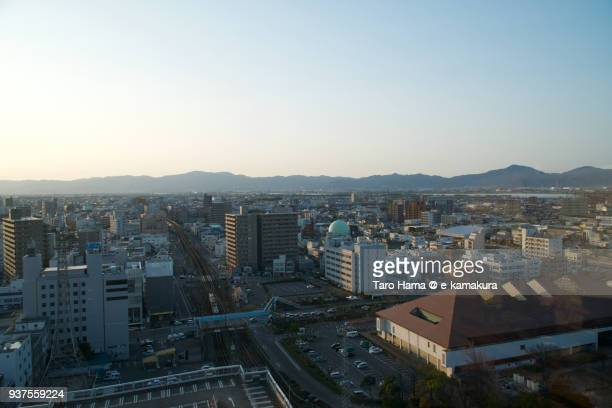 Sanuki Mountains and cityscape in center of Tokushima city in Tokushima prefecture in Japan in the sunset
