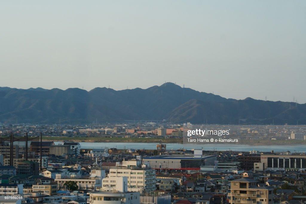 Sanuki Mountains, Yoshino River and cityscape in center of Tokushima city in Tokushima prefecture in Japan : Stock-Foto