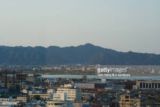 Sanuki Mountains, Yoshino River and cityscape in center of Tokushima city in Tokushima prefecture in Japan