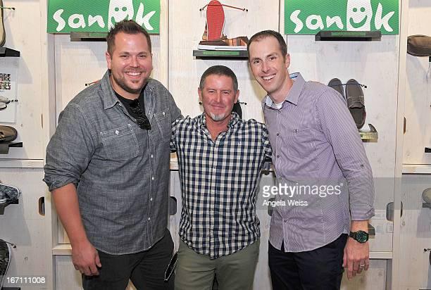 Sanuk's global director of marketing Michael Minter founder of fun footwear company Sanuk Jeff Kelley and Sanuk brand president Jake Brandman attend...