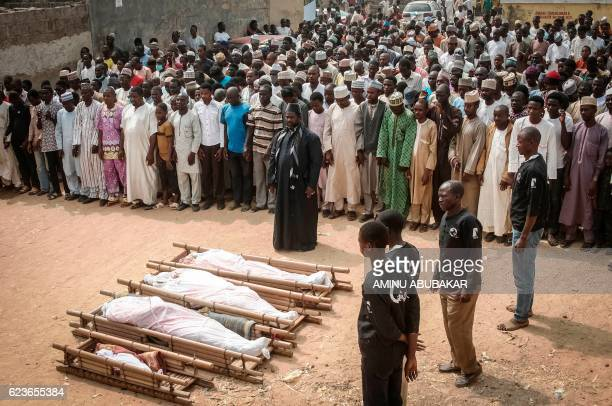 TOPSHOT Sanusi Abdulkadir a leader of the Islamic Movement in Nigeria leads on November 16 2016 in Kano the funeral prayers for the some of the...