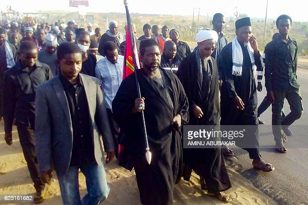 Sanusi Abdulkadir leader of the Kano branch of the proIran Shiite group Islamic Movement of Nigeria carries a flag while leading the members of the...