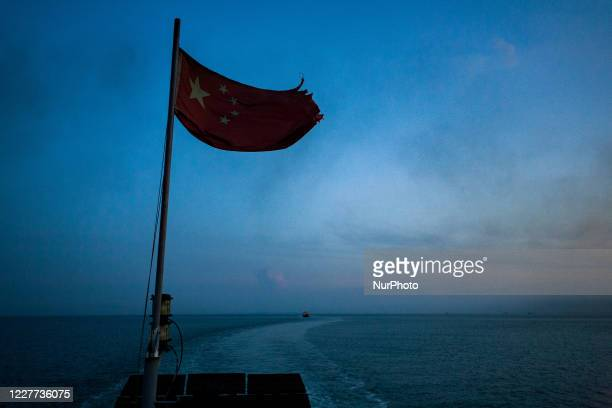 Sanya, China, the 7 august 2011. The chinese flag on a boat in the South China Sea. It is a marginal sea that is part of the Pacific Ocean. The...