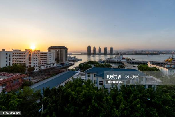 sanya phoenix island president resort apartment, sanya,hainan,china - sunset moth stock photos and pictures