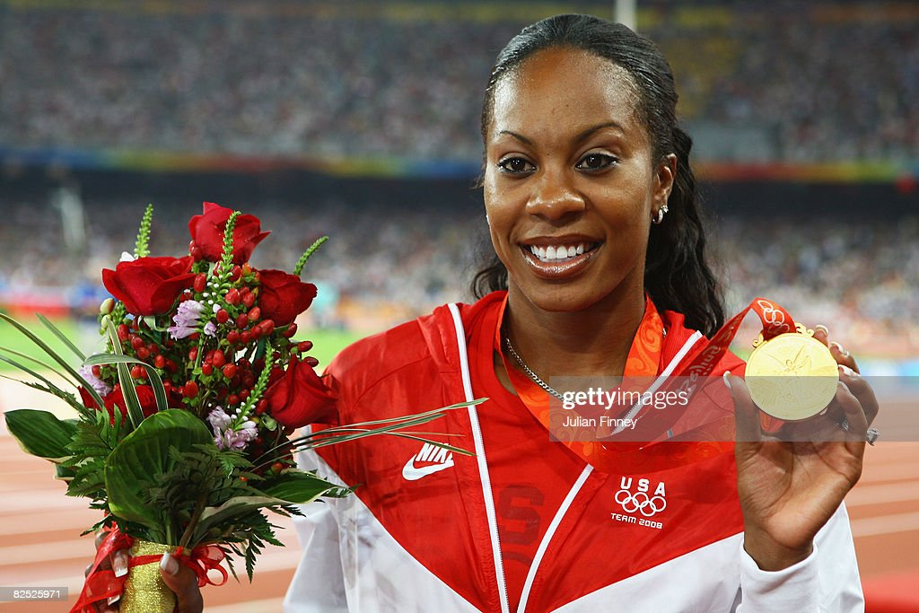 Sanya Richards of the United States poses with her gold medal in the Women's 4 x 400m Relay at the National Stadium on Day 15 of the Beijing 2008 Olympic Games on August 23, 2008 in Beijing, China.
