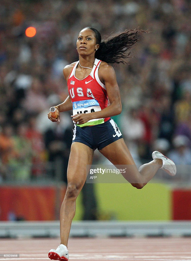 Sanya Richards of the US crosses the finishline to win the women's 4x400m relay final at the 'Bird's Nest' National Stadium during the 2008 Beijing Olympic Games on August 23, 2008. The United States won the Olympic women's 4x400-m relay title in a time of 3mins 18.54secs. Russia was second in 3:18.82 with Jamaica third in 3:20.40.