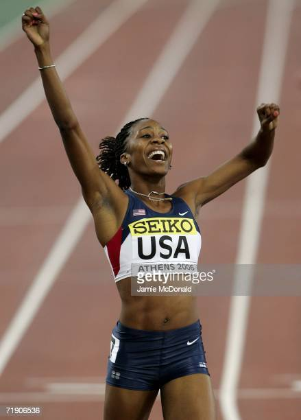 Sanya Richards of the USA celebrates winning the 400m event during the 10th IAAF World Cup at the Olympic Stadium on September 16 2006 in Athens...
