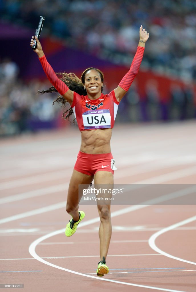 Sanya Richards-Ross of the United States celebrates winning the Women's 4 x 400m Relay Final on Day 15 of the London 2012 Olympic Games at Olympic Stadium on August 11, 2012 in London, England.