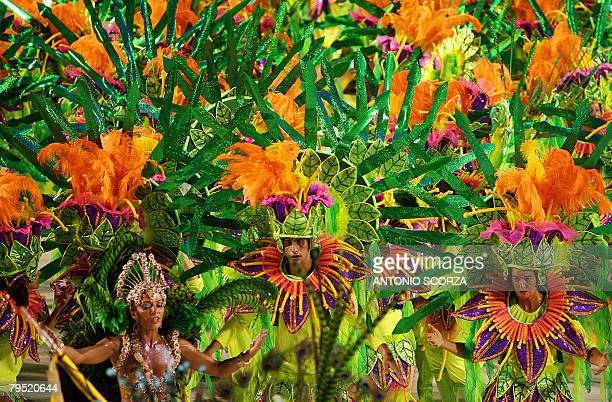 Sao Clemente samba school dancers perform during the first night of the carnival parade at the Sambodrome in Rio de Janeiro on February 3 2008 The...