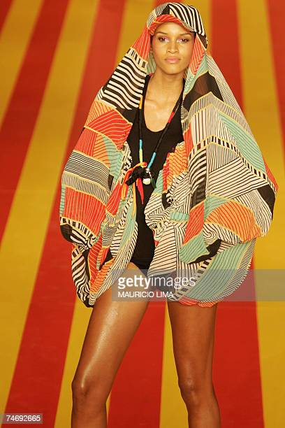 A model presents an outfit by Movimento as part of the SpringSummer 2008 collections of the Sao Paulo Fashion Week in Sao Paulo Brazil 17 June 2007...