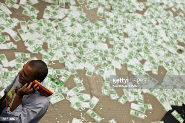 A stock trader is seen next to fake US dollar notes spread on the floor during the launching of the new negotiation pit 'the spot dollar' at the...