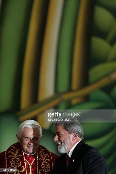 Brazilian President Luiz Inacio Lula da Silva and Pope Benedict XVI smile during a meeting at Bandeirantes Palace in Sao Paulo Brazil 10 May 2007...