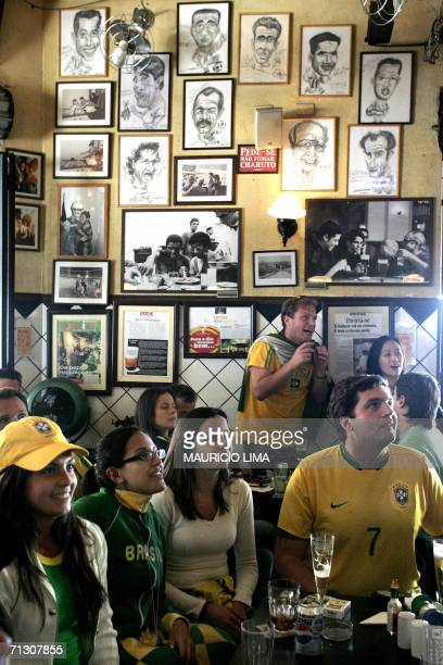 Brazilian soccer fans react during a TV replay of the second goal scored by Adriano, during a FIFA World Cup Germany 2006 football match against...