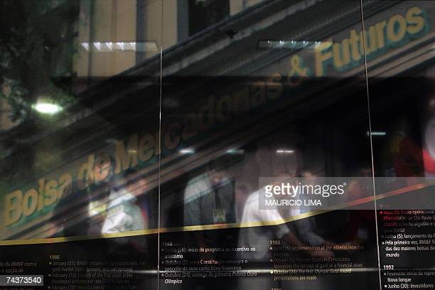 Brazilian stock traders leave at the end of the morning session at the Mercantile Futures Exchange in Sao Paulo Brazil 01 June 2007 Brazil's currency...