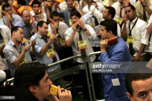 Brazilian stock traders negociate at the iBovespa index pit during the morning session at the Mercantile Futures Exchange in Sao Paulo Brazil 03 May...