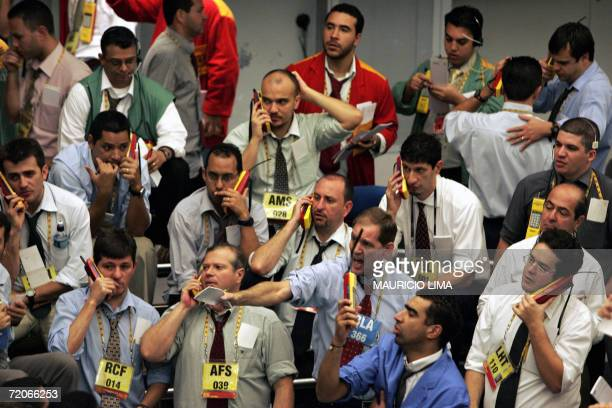 Brazilian stock traders negociate during the morning trade session at the Mercantile Futures Exchange in Sao Paulo Brazil 21 September 2006 As...