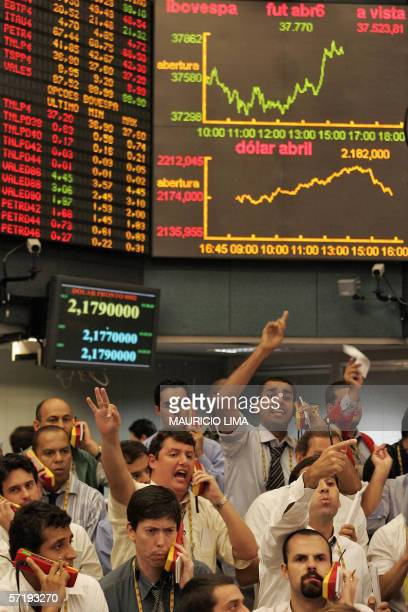 Brazilian stock traders negociate inside the future dollar pit at the Brazilian Mercantile Futures Exchange in Sao Paulo Brazil 27 March 2006 As a...