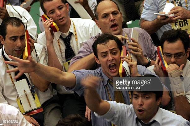 Brazilian stock traders negociate inside the future dollar pit during the morning trade session at the Brazilian Mercantile Futures Exchange in Sao...