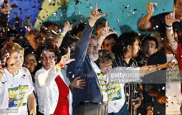 Brazil's reelected President Luiz Inacio Lula da Silva of the Workers' Party first lady Marisa Leticia and supporters make the 'L' for Lula as they...