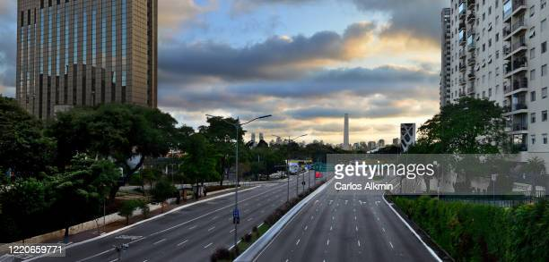 sao paulo, brazil - essential services and all traffic lanes empty in 23 de maio avenue - empty streets stock pictures, royalty-free photos & images