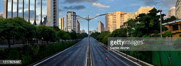 sao paulo, brazil - essential services in a 23 de maio avenue with all lanes empty - empty streets stock pictures, royalty-free photos & images