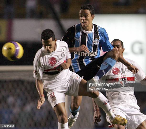 Lucio of Gremio fights for the ball with Souza and Aloisio , both of Sao Paulo FC, during their Libertadores Cup football match between two Brazilian...