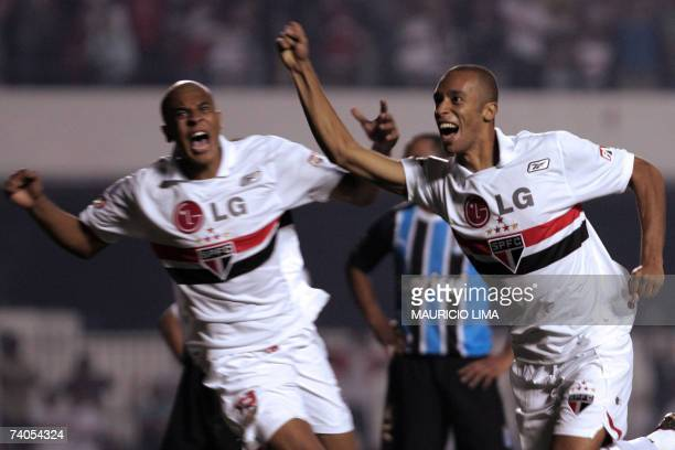 Miranda of Sao Paulo FC celebrates his goal against Gremio followed by teammate Alex Silva during their Libertadores Cup football match between two...