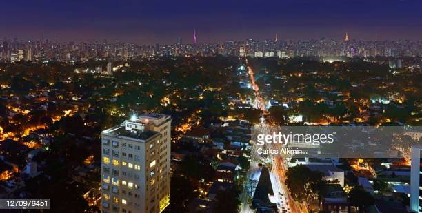 sao paulo, brazil - nighttime city skyline, with a view from faria lima avenue towards paulista avenue - carlos alkmin stock pictures, royalty-free photos & images