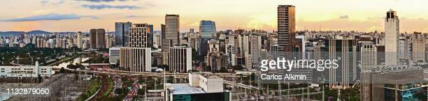 sao paulo, brazil -  panorama part of a day and night series, with the modern skyline of business districts around marginal pinheiros - carlos alkmin stock pictures, royalty-free photos & images