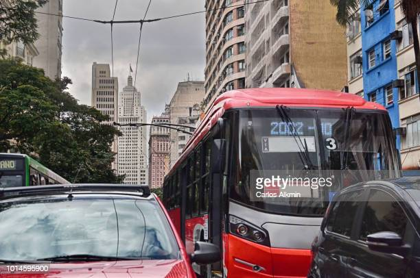 Sao Paulo, Brazil - Sao Joao Avenue traffic with cars and trolley bus